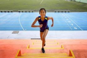 TRAINING: Miss Jeremia Christy Suriadi doing leg exercises at Ngee Ann Polytechnic's stadium.