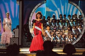 TUTOR: (Above) Ms Teo at the Miss Universe pageant when it was held in Singapore in 1987.