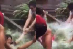 Screengrabs from a video of NUS students involved in a dunking game on Wednesday, Jul 27.