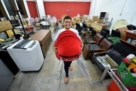 HANDS-ON: Mr Daniel Wong at his company's warehouse in Hillview Terrace.