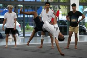 FUN: Mr Dylan Lim (in black) doing 'tricking' with his friends.