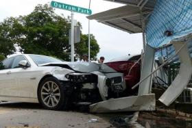 CRASH: A red Mitsubishi was making a right turn at Outram Park when it collided with a BMW (above).
