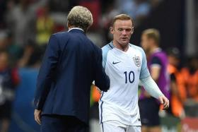 STEPPING IN: England captain Wayne Rooney (No. 10) has revealed that it was his decision to stop Harry Kane from taking corners at Euro 2016, not Roy Hodgson.