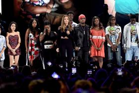Actress Jessica Alba (centre) speaks out against gun violence with victims and victims' families of gun violence attacks onstage during Teen Choice Awards 2016 at The Forum on July 31, 2016