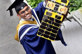 SUCCESS: Valedictorian A Saravanan with a satellite from NTU's Satellite Research Centre.