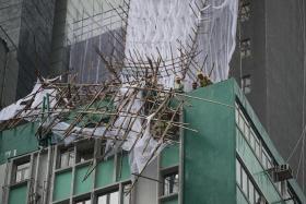 HAVOC: (Above) Bamboo scaffolding in Hong Kong damaged by Typhoon Nida.