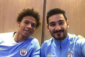 NEW CITIZENS: Man City's new signing Leroy Sane (left) posing with fellow German and clubmate Ilkay Guendogan.