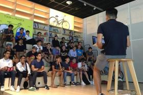 ALL EARS: National cycling coach Adrian Ng (far right) addressing the new national squad for the first time on Friday.