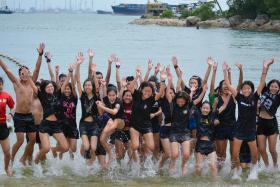 Undergraduates at Nanyang Technological University (NTU) enjoying themselves at a beach during an orientation programme.