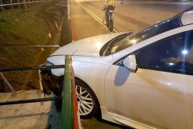CRASH: Mr Vasily's car hit a kerb and a railing at the junction of Mei Chin Road and Mei Ling Street when he was trying to overtake the car in front of him.