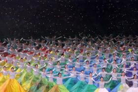 NDP ART:(Above) Performers flipped their skirts to create a mass display of the artworks.