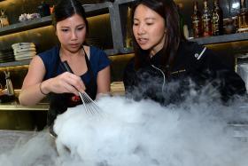 COOL: Masterchef Australia Season 8 contestant Karmen Lu (left) and local pastry chef Janice Wong create whisky ice cream.