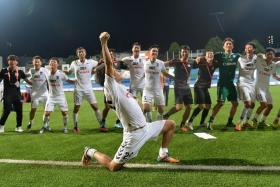 WINNING FEELING: Albirex celebrate after taking The New Paper League Cup title last month.
