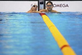 HE'S COME A LONG WAY: Joseph Schooling, when he was 13, with his idol Michael Phelps eight years ago, and Schooling with Phelps in Rio (above), where the Singaporean will try to beat the swimming legend in the 100m butterfly final this morning.