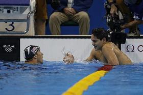 FRIENDLY: Michael Phelps (left) and Joseph Schooling (right) can share more than just their rivalry in the pool.