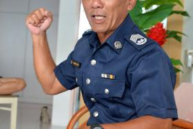 VOLUNTEERS: VSC officers Senior Station Inspector Johnny Boon (above) and Staff Sergeant Mohamad Ariff Said Abdul Kader.