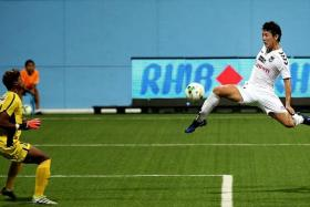 FLIGHT OF THE WHITE SWAN: Albirex's Atsushi Kawata trying to get the better of Balestier goalkeeper Naqiuddin Nodin.