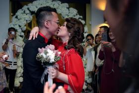 Singapore Idol 3 winner Sezairi Sezali and wife Syaza Qistina Tan at their wedding reception on Aug 21 at the SAF Yacht Club in Tanah Merah.