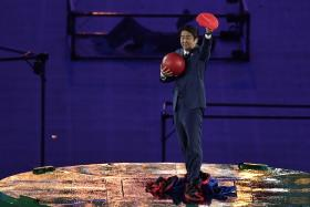 Shinzo Abe, dressed as Mario, appeared on stage from a green pipe, Super Mario style.