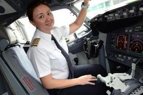 PIONEER: Captain Debbie Aw is one of nine female pilots with SilkAir.