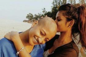COURAGE: Vimala Velu shaved her head (above) in 2014 in support of fund-raising event Hair for Hope.