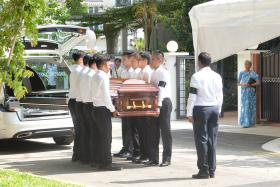 Mr S R Nathan's casket arriving at his home at Ceylon Road.