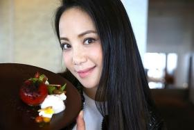 PRETTY: Fiona Xie and the Maple-Cured Rainbow Trout at French restaurant Jaan.