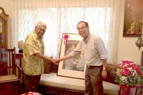 PROUD: Mr Chung presented the painting to Mr Nathan at his home on his 90th birthday.