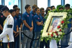 Footballers from Home United pay their last respects to former President S R Nathan.