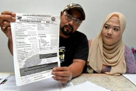 UPSET:Mr Muhammad Aslam and his fiancee, Ms Siti Fadilah, also believe they were issued fake receipts by Mr Sunato Zaidi.