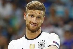 TIME TO GO: German centre back Shkodran Mustafi (above) is set to join Arsenal from Valencia after undergoing a medical in north London yesterday.