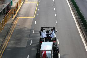 PROCESSION: Mr S R Nathan's cortege on Ganges Road en route to the University Cultural Centre (UCC) at the National University of Singapore.