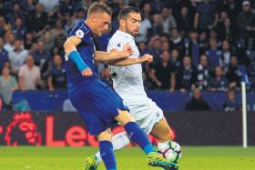 ON TARGET: Leicester frontman Jamie Vardy runs in behind the Swansea defence to score his first goal of the season.
