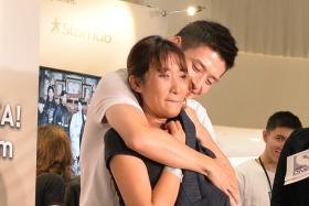 FAN SERVICE: South Korean actor Kang Ha Neul giving Ms Emma Muhammad a hug.