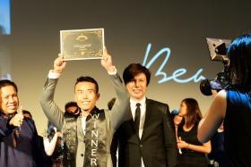 Manhunt Senior winner Mr Stanley Nam (centre) made a beeline for his mother when he was announced as the winner.