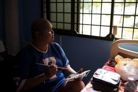 GOODBYE: Young artist Muhammad Khairul Ikhwan would paint to find solace from stage 4 colon cancer. He died on Sunday.