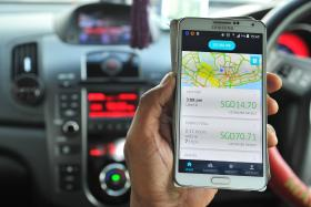 An Uber driver showing the app on his phone.