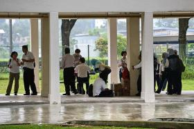 INSPECTION: NEA officers gather before inspecting homes in Aljunied yesterday.