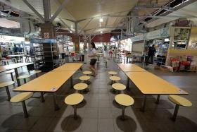 WORRYING: All was unnaturally quiet at Sims Vista Market and Food Centre yesterday afternoon.