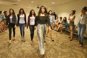 LEARNING FROM THE BEST: Pat Kraal showing the New Face pageant finalists how to take small steps at the end of the runway during her catwalk coaching session.