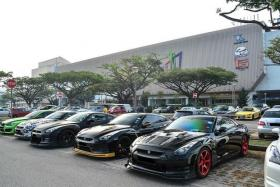 DISPLAY: Supercars lined up at the carpark make it easy for enthusiasts to admire them.