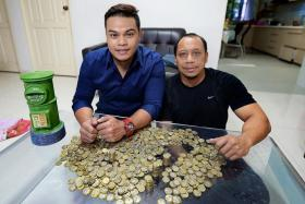 SUPER SAVER: Mr Muhammad Helmy Kamid started saving $1 coins two years ago. He was inspired by his uncle, Mr Anuar Ahmad (above, right).