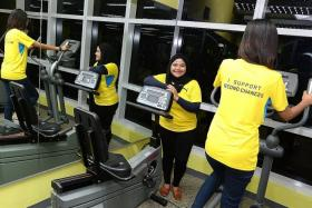 TEAMWORK: Ms Siti (above) agreed to run with Bella (back to camera) even though she had a baby four months ago.