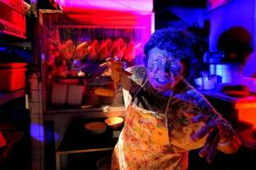 YOU'RE DEAD MEAT: A zombie in front of her chicken rice stall from the Hawker Centre Massacre.