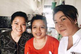 HELPING HAND: Ms Karen Chan (in white) visited Madam Jurina in July to give her the vouchers. Also in the picture is Ms Chan's friend.
