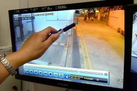 DISTURBANCE: The CCTV footage showing the group of men fighting at a back alley behind the condominium in Jalan Besar.