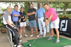 GEARING UP: (Above, from left) Lee Kian, Colin Tan, Clara Ang, Erwyn Lam, golf instructor M Balraj, and Melvin Choo go through a fitting session at Orchid Country Club before their WAGC outing.