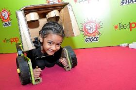 CUTE: Nur Nyla Qamelia, eight, had a Bumblebee outfit. The Transformer character get-up was put together by her father and it allowed her to turn into a car like her character.