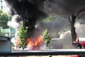 SMOKE: Advance Coach bus service AC7 in flames at Yishun Avenue 5.