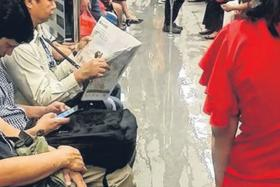 WET: Rainwater flowed into train cabins, wetting the floors.